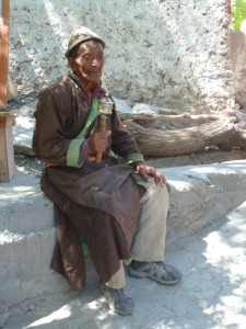 Old guy with prayer wheel at Alchi, looking very serious for the camera