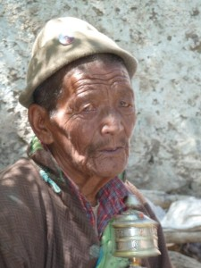 old guy with prayer wheel. He grinned like anything the moment I stopped photographing him!