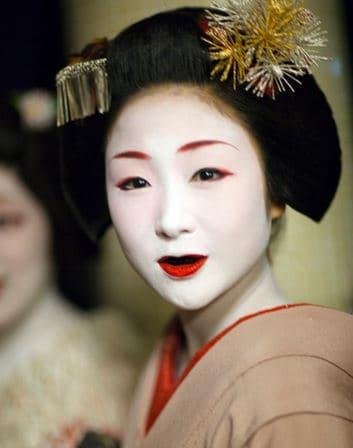 A geisha with blackened teeth