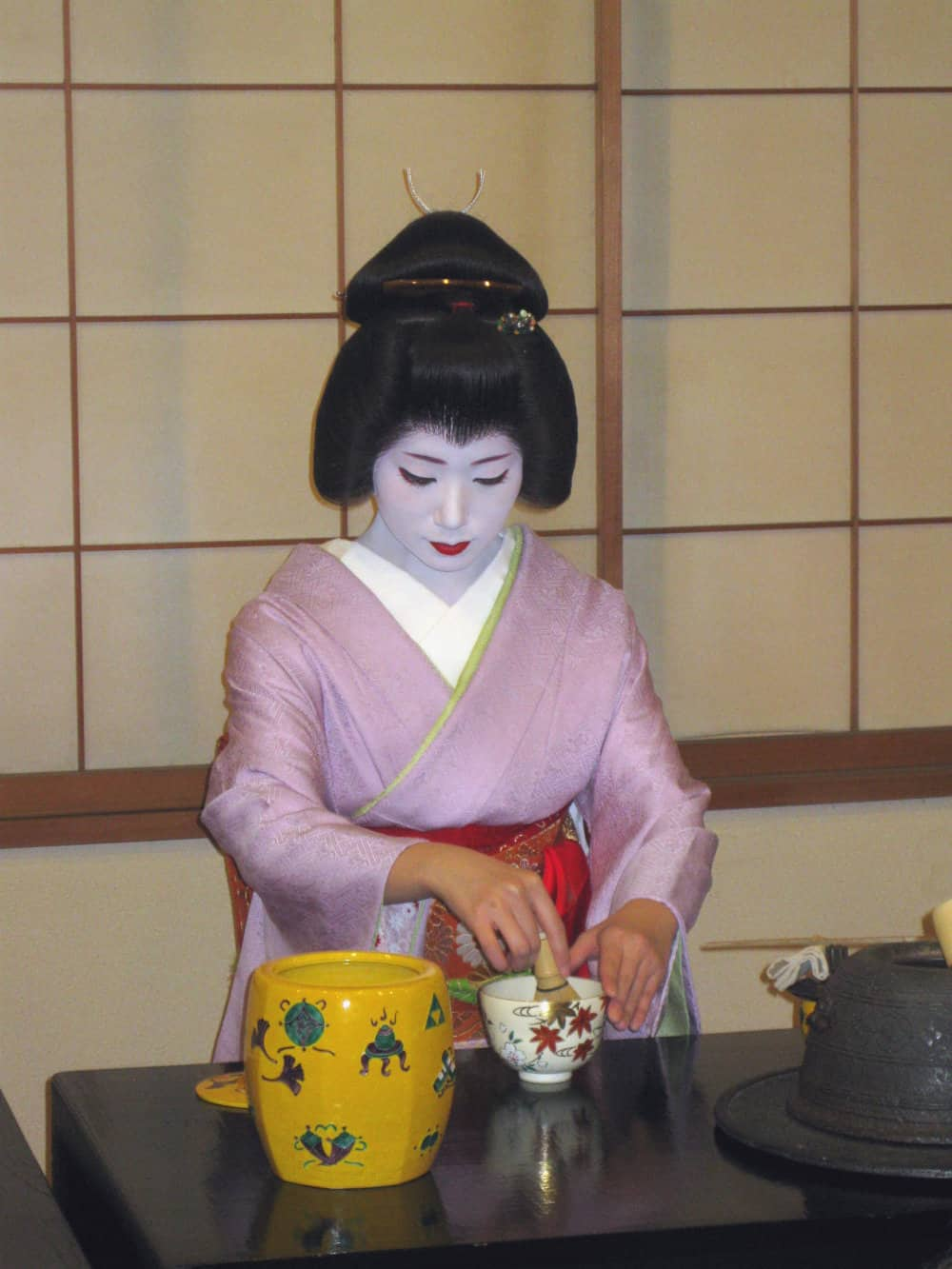A geisha in Kyoto whisking up a bowl of green tea