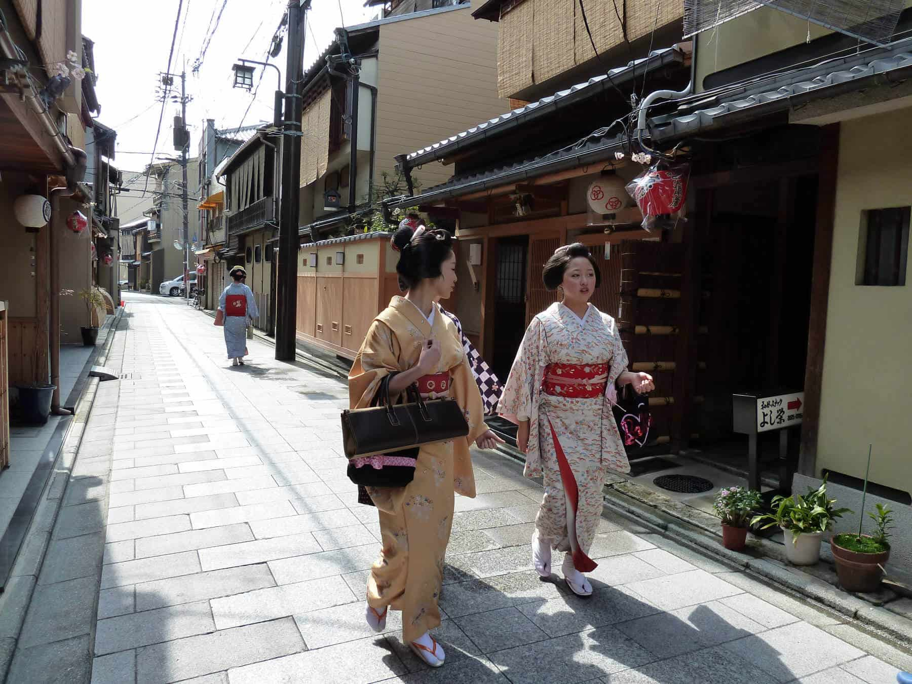 Maiko on the 'narrow street lined with dark wooden houses' where I lived in Kyoto