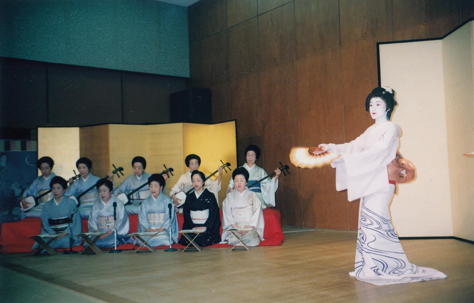 Geisha dancing with geisha accompaniment